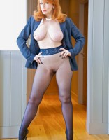Redhead business lady strips off her pantsuit to plays with herself in seamless pantyhose