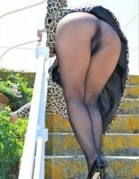 Elegant mature lady in black seamless pantyhose