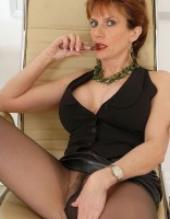 Hot mature Lady Sonia in black pantyhose strokes her crotch with high heeled shoes